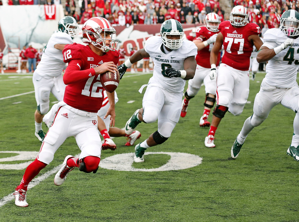 . Indiana quarterback Zander Diamont (12) scrambles out of the pocket in first half of an NCAA college football game in Bloomington, Ind., Saturday, Oct. 18, 2014. Michigan State won the game 56-17. (AP Photo/Sam Riche)