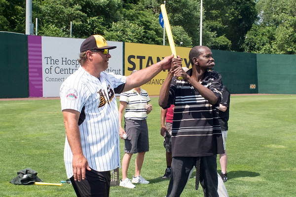 07/02/19 Wesley Bunnell | Staff The New Britain Bees welcomed group home members to New Britain Stadium as part of the Beautiful Lives Project on Tuesday July 2, 2019.Bees players and coaches played wiffle ball games on the outfield grass with the participants. Head coach Mauro Gozzo helps Wilbur Frazier from CCARC with his batting approach.