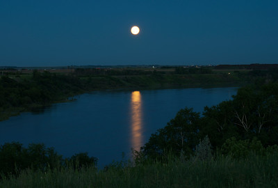 Full Moon reflecting on the smooth river