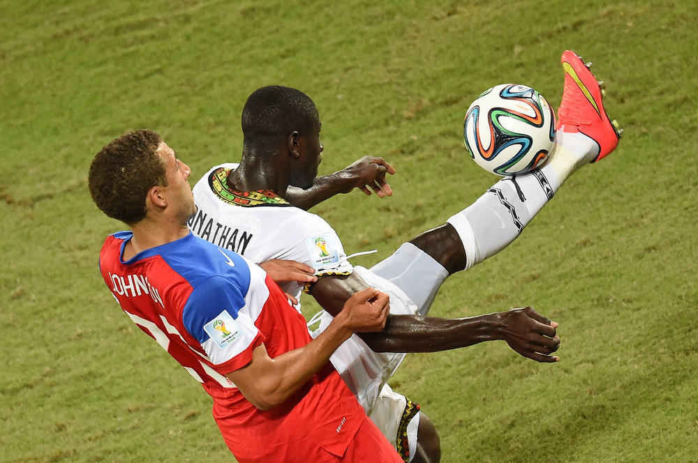. US defender Fabian Johnson (L) vies with Ghana\'s defender Jonathan Mensah (R) during a Group G football match between Ghana and US at the Dunas Arena in Natal during the 2014 FIFA World Cup on June 16, 2014.  AFP PHOTO / JAVIER SORIANOJAVIER SORIANO/AFP/Getty Images