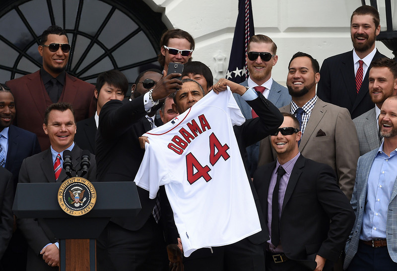 . Red Sox Designated Hitter David Ortiz (L) takes a selfie with US President Barack Obama after presenting his a jersey during a ceremony on the South Lawn at the White House in Washington, DC, on April 1, 2014.  Obama honored the Boston Red Sox for their 2013 World Series Championship. (JEWEL SAMAD/AFP/Getty Images)