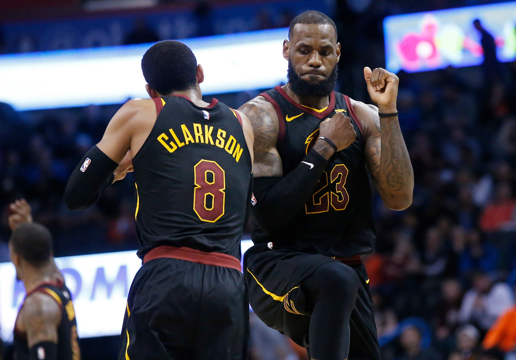 . Cleveland Cavaliers forward LeBron James (23) celebrates with teammate Jordan Clarkson during the second half of the team\'s NBA basketball game against the Oklahoma City Thunder in Oklahoma City, Tuesday, Feb. 13, 2018. (AP Photo/Sue Ogrocki)