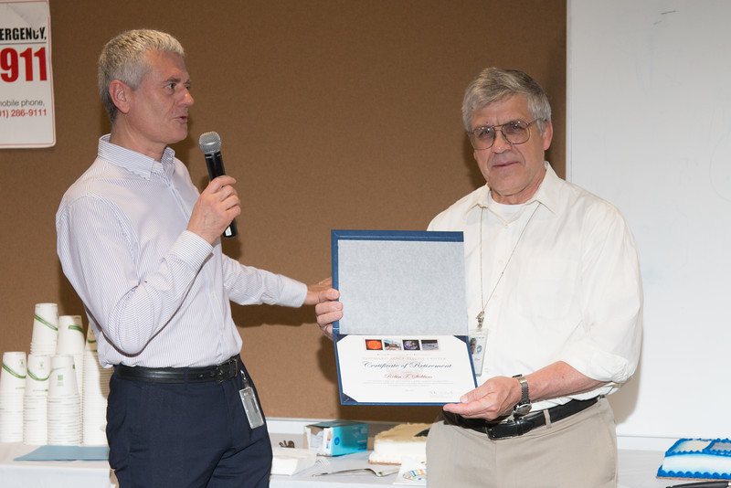 "Division Director Mark Clampin presents Tuck with retirement certificate  -- Retirement party for Robin ""Tuck"" Stebbins, NASA/GSFC, May 20, 2016"