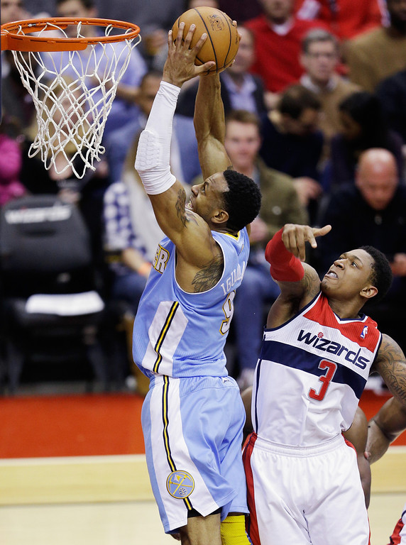 . WASHINGTON, DC - FEBRUARY 22: Andre Iguodala #9 of the Denver Nuggets shoots over Bradley Beal #3 of the Washington Wizards during the first half at Verizon Center on February 22, 2013 in Washington, DC.  (Photo by Rob Carr/Getty Images)