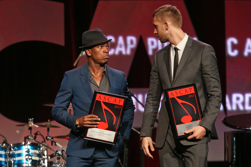 . Ne-Yo (L) and Calvin Harris (R) receive an award on stage during the 30th Annual ASCAP Pop Music Awards at Loews Hollywood Hotel on April 17, 2013 in Hollywood, California.  (Photo by Paul A. Hebert/Getty Images)