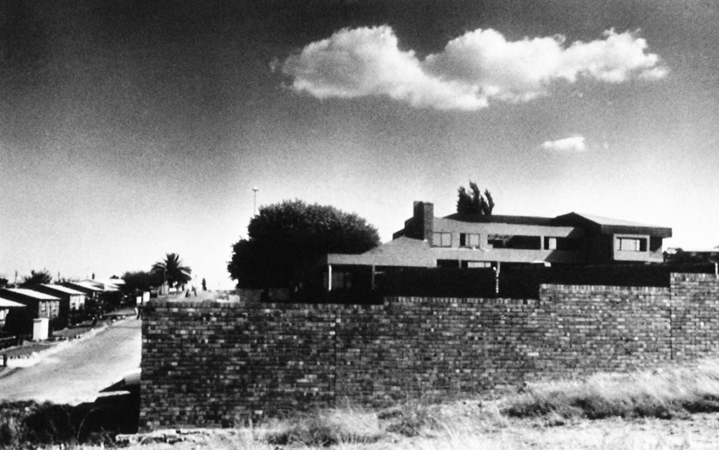 ". The two-story house of Winnie Mandela, wife of imprisoned African National Congress leader Nelson Mandela, is enclosed by brick walls in the Soweto section of Johannesburg, South Africa. Mrs. Mamdela confirmed in an interview published on Thursday, May 10, 1987  in the Weekly Mail that she has been building the house since mid-1986 with royalties from hour biography "" Part of My Soul Went with Him,\"" and with money from a trust fund she said was set up by friends. (AP Photo)"