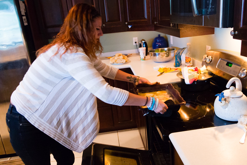 Shelby Sparrow, 21, of Plantation, Florida,  removes the pork chops from the oven. Sparrow is preparing dinner for the residents of All About Recovery's younger women's sober home in Loxahatchee, Florida on Wednesday, June 1, 2016. Sparrow, a recovering heroin addict has been in the sober home since February 2016 and has been clean for five months. (Joseph Forzano / The Palm Beach Post)