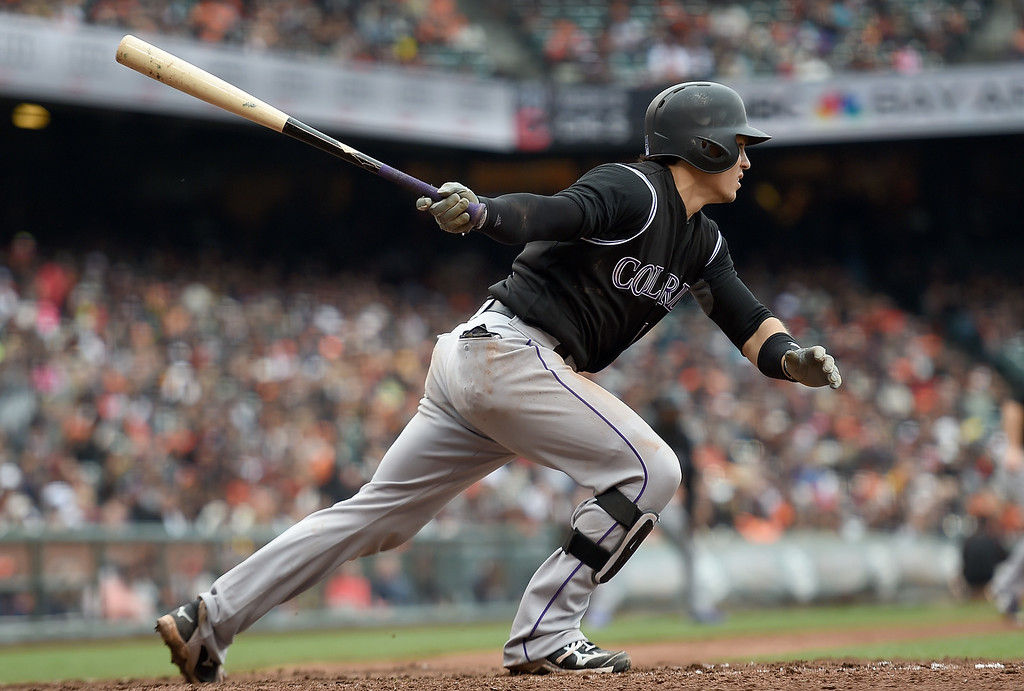 . SAN FRANCISCO, CA - MAY 07:  Tony Wolters #14 of the Colorado Rockies hits an rbi double scoring DJ LeMahieu #9 against the San Francisco Giants in the top of the tenth inning at AT&T Park on May 7, 2016 in San Francisco, California.  (Photo by Thearon W. Henderson/Getty Images)