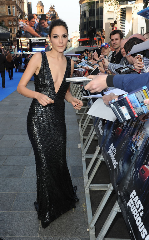 """. Actress Gal Gadot attends the \""""Fast & Furious 6\"""" World Premiere at The Empire, Leicester Square on May 7, 2013 in London, England.  (Photo by Stuart C. Wilson/Getty Images for Universal Pictures)"""
