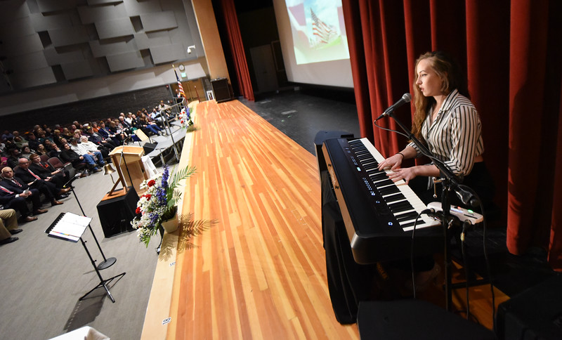 "North Warren Regional High School senior, Andie Baldwin, performs ""Ballad of the Heart"", a song she composted. Phillipsburg area veterans Sunday, Nov. 11, 2018  were honored during the 21st annual William L. Nixon tribute. Hundreds attended the event at Phillipsburg High School in Lopatcong Township, in which the U.S. Department of Veterans Affairs has honored as a regional site for the observance of the commemoration."