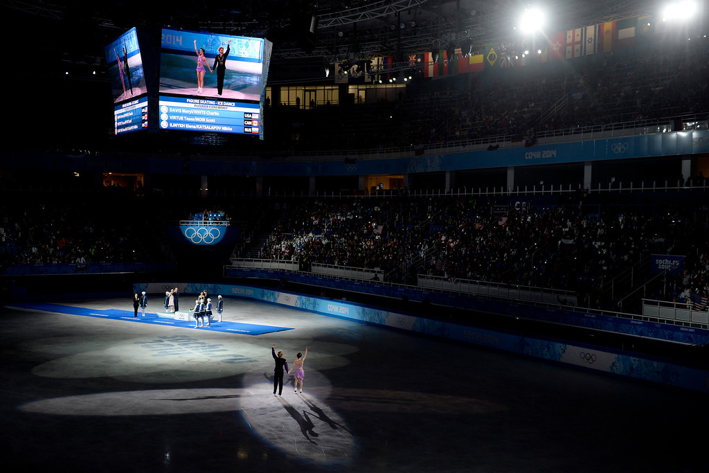. Gold medalists Charlie White and Meryl Davis of the U.S.A. wave to the crowd as they skate onto the ice to take the podium after the figure skating ice dancing free dance. Sochi 2014 Winter Olympics on Monday, February 17, 2014. (Photo by AAron Ontiveroz/The Denver Post)