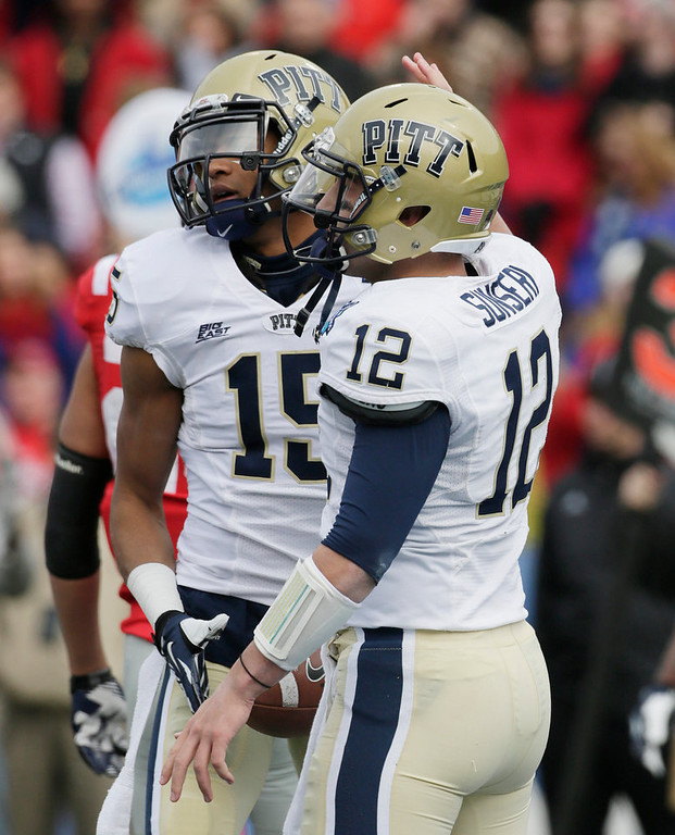 . Pittsburgh quarterback Tino Sunseri (12) congratulates teammate Devin Street (15) after a touchdown reception  against Mississippi during in the first half of the BBVA Compass Bowl NCAA college football game at Legion Field in Birmingham, Saturday, Jan. 5, 2013. (AP Photo/Dave Martin)