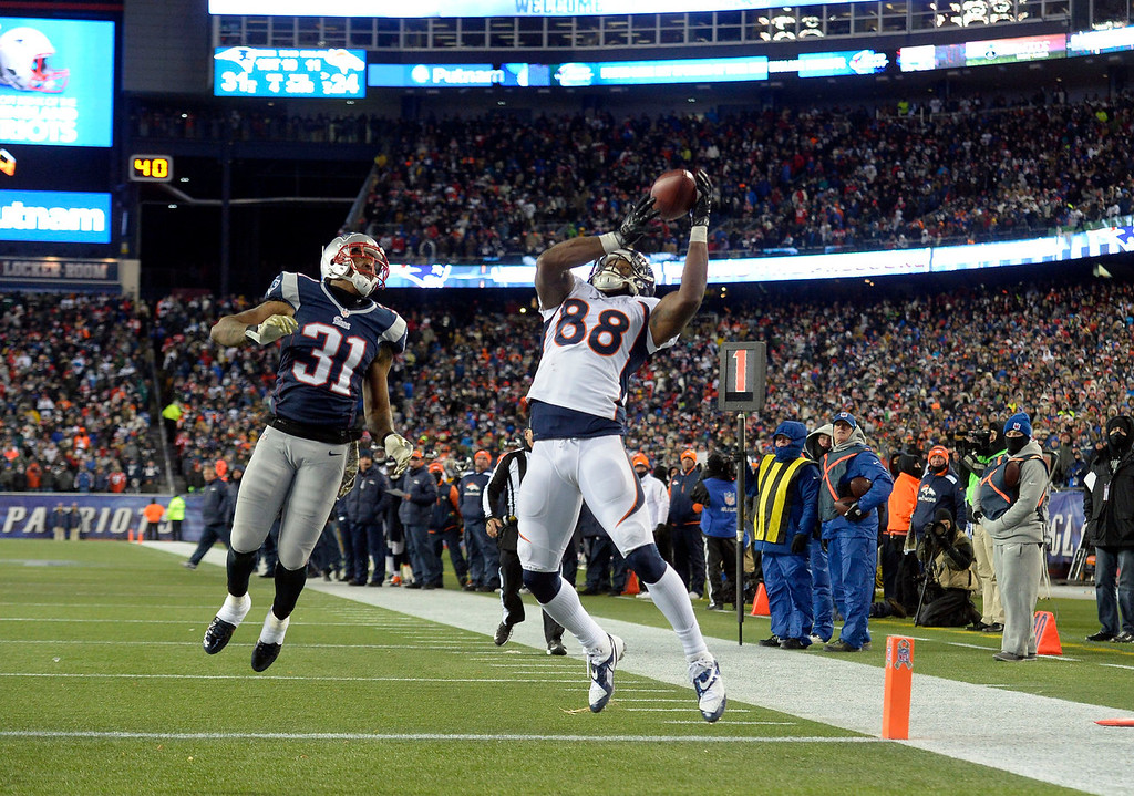. Denver Broncos wide receiver Demaryius Thomas (88) reaches to haul in a touchdown over New England Patriots cornerback Aqib Talib (31) during the fourth quarter November 24, 2013 at Gillette Stadium. (Photo by John Leyba/The Denver Post)