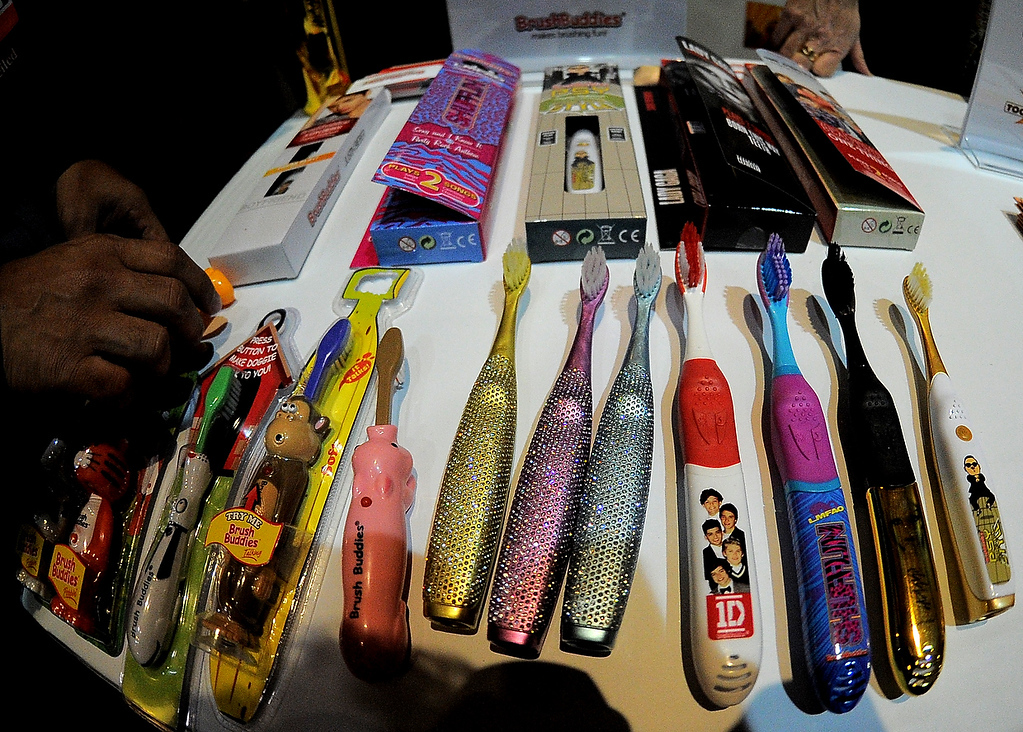 . Brushbuddies dislays talking singing and popping-up tooth brushes during the opening event \'\'CES Unveiled\'\'  during the  International Consumer Electronics Show (CES) in Mandalay Bay Hotel resort on January 6, 2013 in Las Vegas, Nevada. (JOE KLAMAR/AFP/Getty Images)