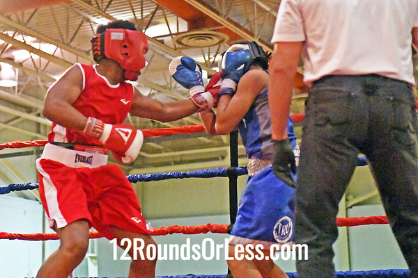 Bout #5:  Quincy Harris, Red Gloves, 65th Street BC  vs  Zechariah McMillian, Blue Gloves, Blue Steel BC,  145 lb. Intgermediate Division Championship Bout
