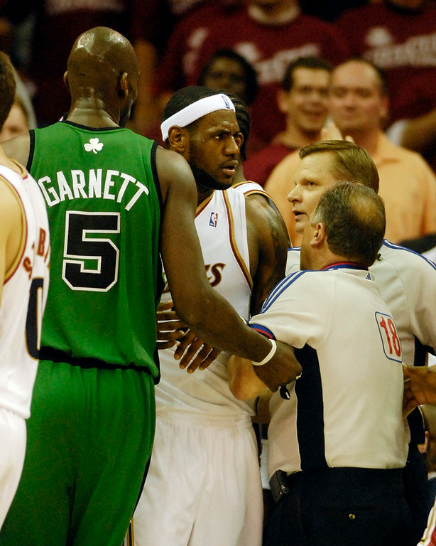 . Game referees keep a hold on Cavaliers LeBron James after he was fouled by Celtics Paul Pierce during the second quarter of Game 4 of the Eastern Conference Championships Monday.