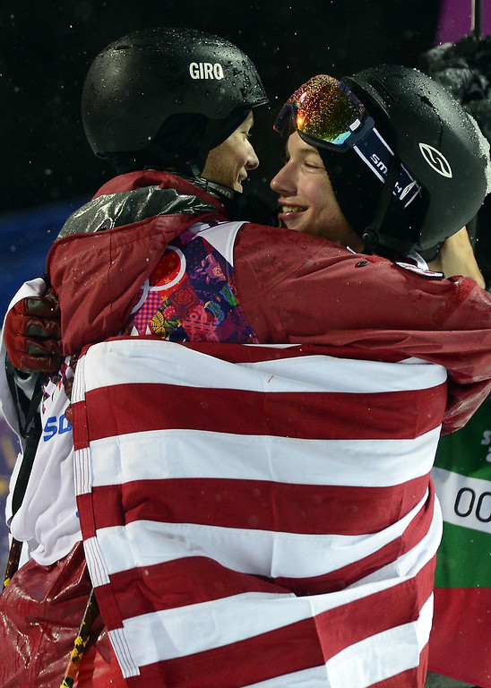 . Silver Medallist, Canada\'s Mike Riddle hugs Gold Medallist, US David Wise as they celebrate in the Men\'s Freestyle Skiing Halfpipe finals at the Rosa Khutor Extreme Park during the Sochi Winter Olympics on February 18, 2014.  JAVIER SORIANO/AFP/Getty Images