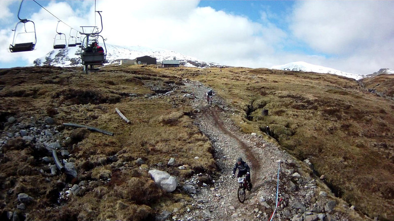 Chair lift up; lots of mountain bikers.