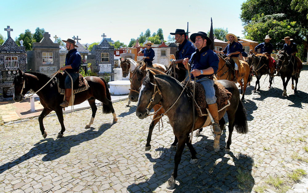 Description of . Members of the Gaucho Traditions Center ride on horses along the Municipal cementery to pay homage to their fellow member Silvio Beuren, one of the victims of the blaze in a disco on the eve, at the municipal cementery on January 28, 2012 in Santa Maria, southern Brazil.  A massive blaze at a nightclub in Brazil killed more than 230 people and left relatives desperately searching for loved ones as horrific accounts emerged of a tragic rush to escape the inferno.  ANTONIO SCORZA/AFP/Getty Images