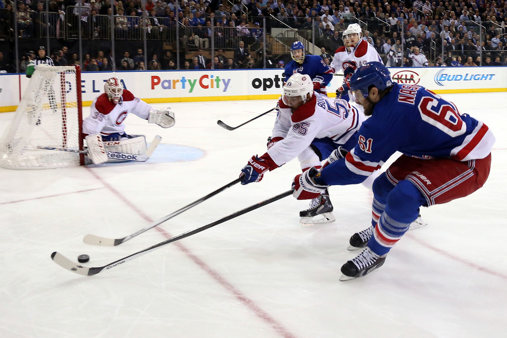 . Rick Nash #61 of the New York Rangers and Francis Bouillon #55 of the Montreal Canadiens battle for the puck during Game Six of the Eastern Conference Final in the 2014 NHL Stanley Cup Playoffs at Madison Square Garden on May 29, 2014 in New York City.  (Photo by Bruce Bennett/Getty Images)