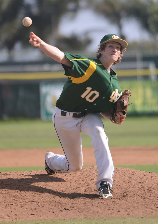 . Mira Costa starting pitcher #10 Christian Reynolds got the win, going 6 1/3 innings as Mira Costa defeated Westchester 2-1 at home in boy\'s baseball.  Photo by Brad Graverson 3-26-13
