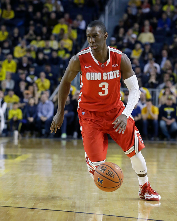. Ohio State guard Shannon Scott (3) dribbles during the second half of an NCAA college basketball game against Michigan, Sunday, Feb. 22, 2015 in Ann Arbor, Mich. Michigan defeated Ohio State 64-57. (AP Photo/Carlos Osorio)