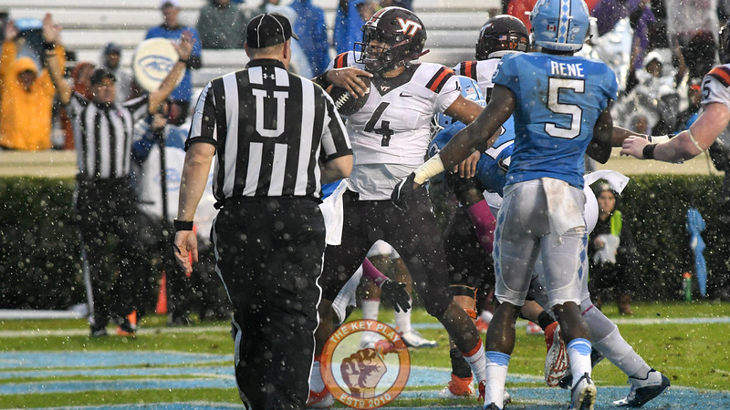 Virginia Tech quarterback Jerod Evans (4) carries the ball into the end zone on 4th and goal to put the Hokies ahead 26-3. (Michael Shroyer/ TheKeyPlay.com)