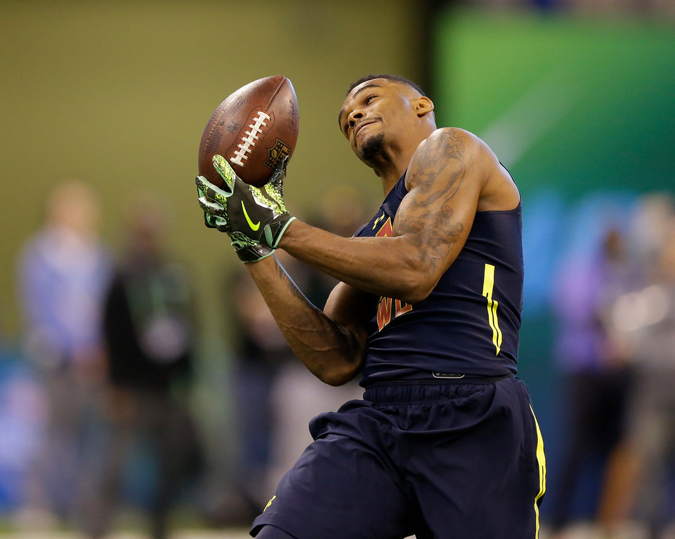 . West Virginia wide receiver Shelton Gibson runs a drill at the NFL football scouting combine in Indianapolis, Saturday, March 4, 2017. (AP Photo/Michael Conroy)