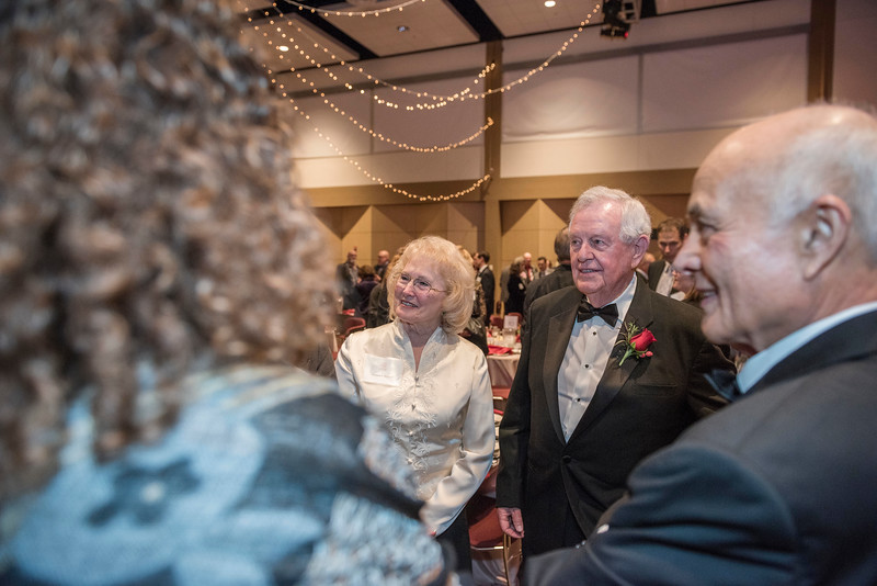 Lorrene Watters (left) with Distinguished Alumni recipient Gary Watters (CIVL, '57) (right) during an evening dinner on Friday, March 9, 2018 in Chico, Calif.  (Jason Halley/University Photographer/CSU Chico)