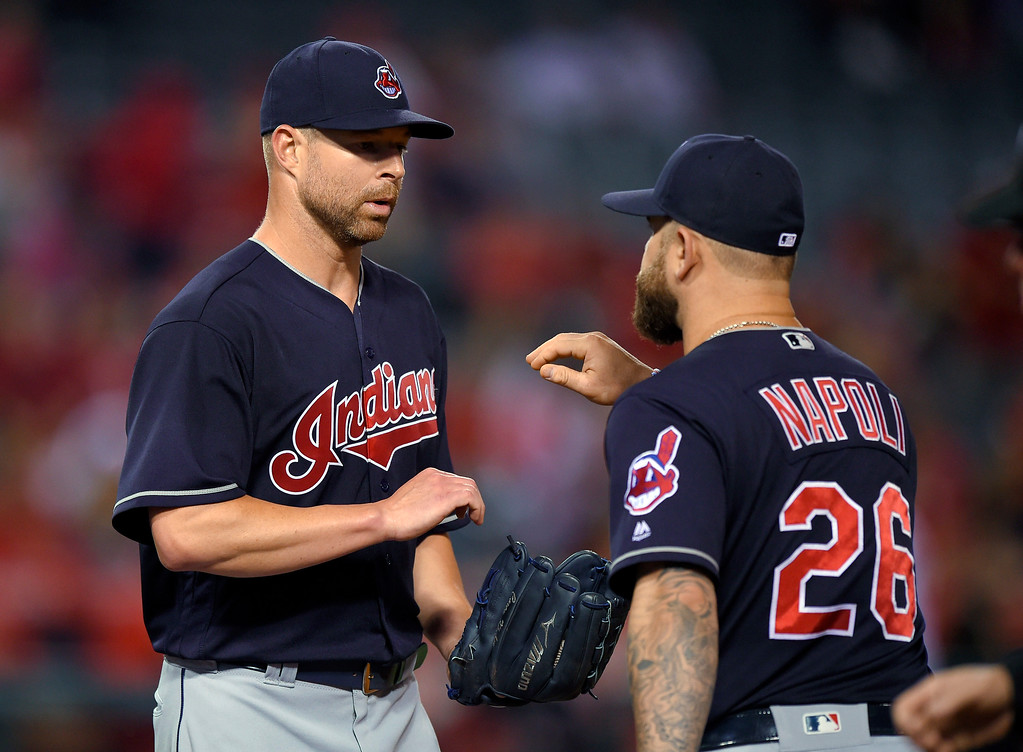 . Cleveland Indians starting pitcher Corey Kluber, left, is congratulated by first baseman Mike Napoli after the Indians defeated the Los Angeles Angels 6-2 in a baseball game, Friday, June 10, 2016, in Anaheim, Calif. (AP Photo/Markp J. Terrill)