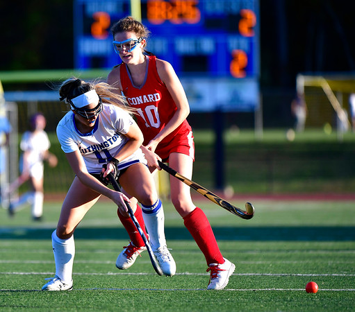 10/15/2019 Mike Orazzi | Staff Conard High School's Sarah Gallagher (10) and Southington High School's Jenna Sheehan (11) during a 2-2 tie in field hockey action in Southington on Tuesday afternoon.