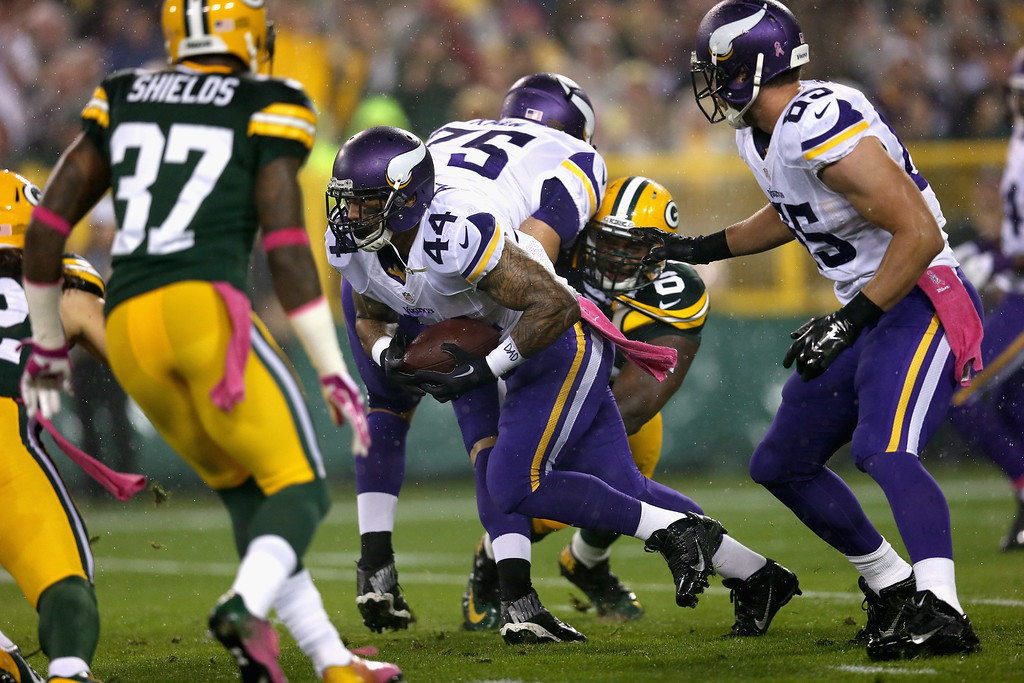 . GREEN BAY, WI - OCTOBER 02:  Matt Asiata #44 of the Minnesota Vikings drives the football one yard against the Green Bay Packers in the first period at Lambeau Field on October 2, 2014 in Green Bay, Wisconsin. (Photo by Jonathan Daniel/Getty Images)