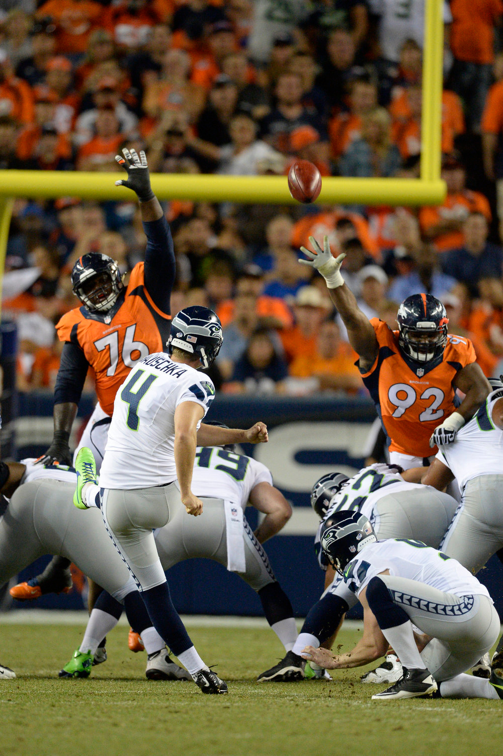 . Seattle Seahawks kicker Steven Hauschka (4) kicks a 41 yard FG to put he Seahawks on top 10-7 during the second quarter agains the Denver Broncos August 7, 2014 at Sports Authority Field at Mile High Stadium.  (Photo by John Leyba/The Denver Post)