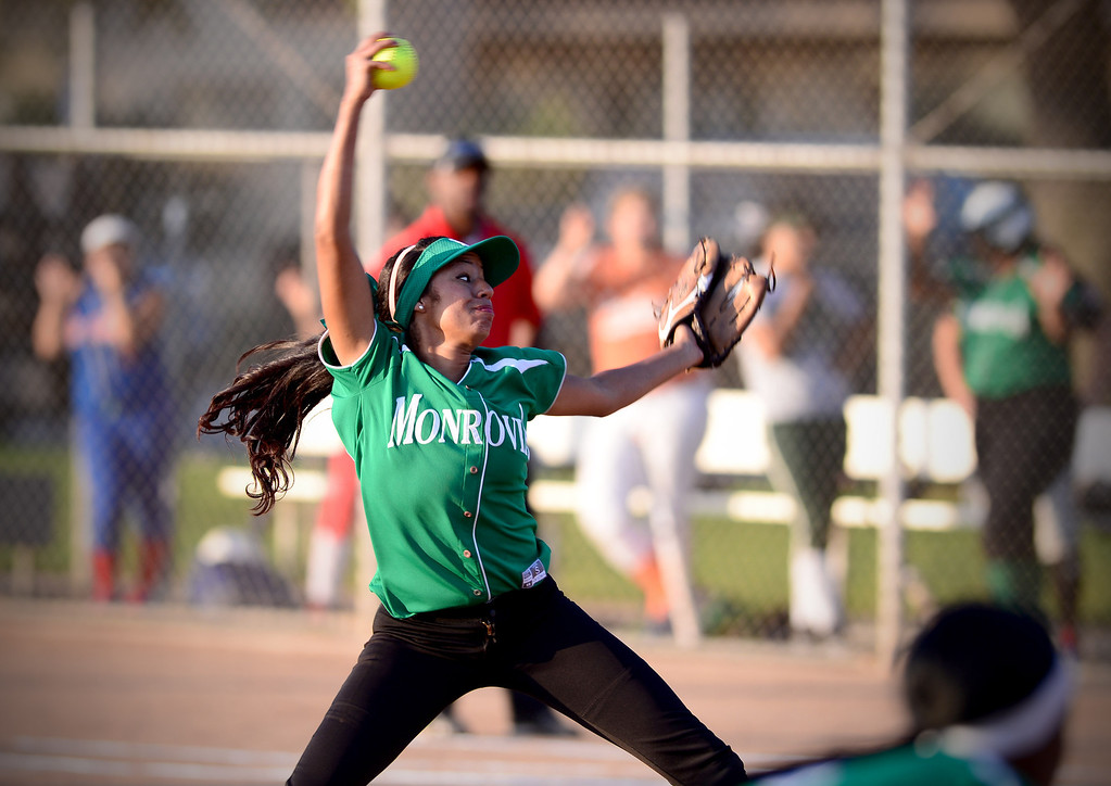 . Monrovia\'s Adrienne Guerra (00) pitches during the West SGV softball all-star game Wednesday night, June 11, 2014 at Live Oak Park in Temple City. (Photo by Sarah Reingewirtz/Pasadena Star-News)