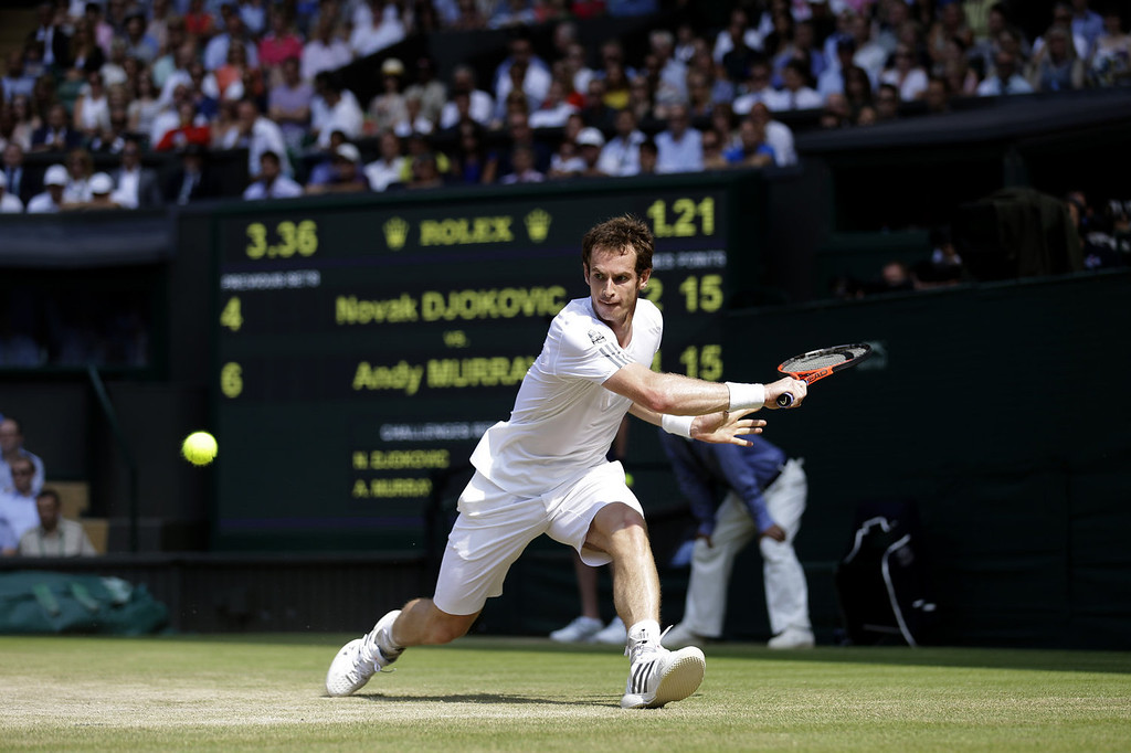 . Andy Murray of Great Britain hits a backhand during the Gentlemen\'s Singles Final match against Novak Djokovic of Serbia on day thirteen of the Wimbledon Lawn Tennis Championships at the All England Lawn Tennis and Croquet Club on July 7, 2013 in London, England.  (Photo by Pool/Getty Images)