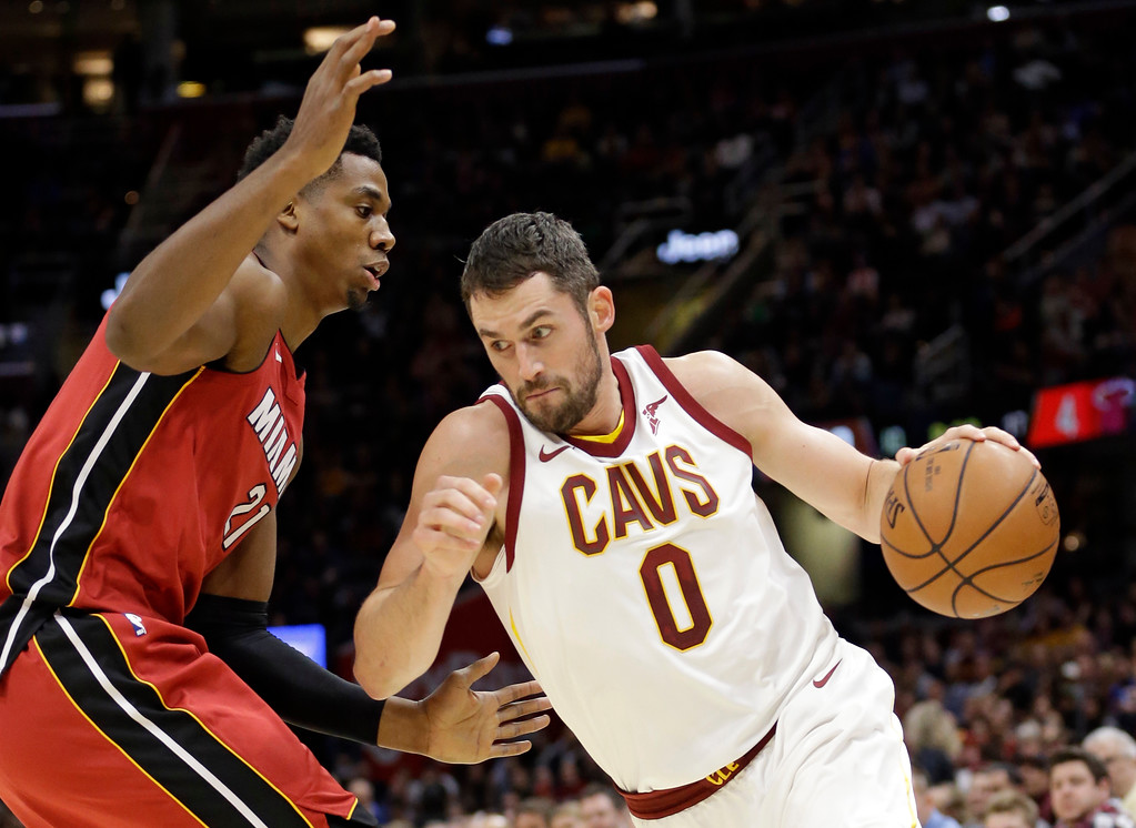 . Cleveland Cavaliers\' Kevin Love (0) drives against Miami Heat\'s Hassan Whiteside (21) in the first half of an NBA basketball game, Tuesday, Nov. 28, 2017, in Cleveland. (AP Photo/Tony Dejak)
