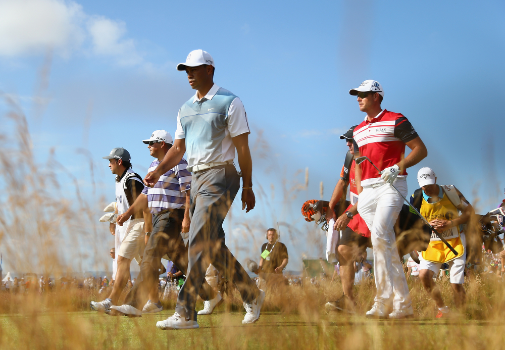 . Tiger Woods of the United States walks off the 2nd tee with Henrik Stenson of Sweden during the first round of The 143rd Open Championship at Royal Liverpool on July 17, 2014 in Hoylake, England.  (Photo by Matthew Lewis/Getty Images)