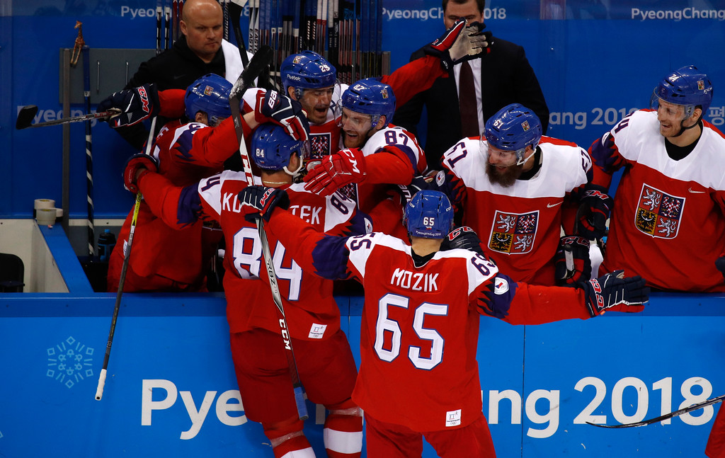 . Tomas Kundratek (84), of the Czech Republic, celebrates with his teammates after scoring a goal against the United States during the second period of the quarterfinal round of the men\'s hockey game at the 2018 Winter Olympics in Gangneung, South Korea, Wednesday, Feb. 21, 2018. (AP Photo/Jae C. Hong)