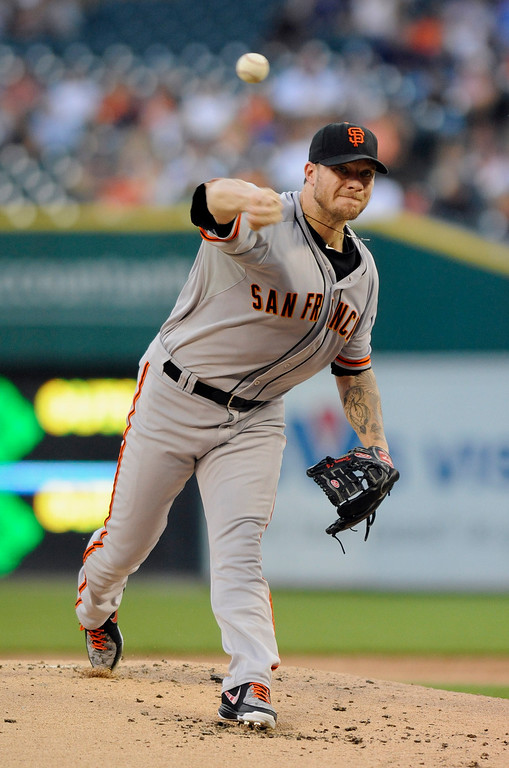 . San Francisco Giants pitcher Jake Peavy throws against the Detroit Tigers in the first inning of a baseball game Friday, Sept. 5, 2014, in Detroit. (AP Photo/Jose Juarez)