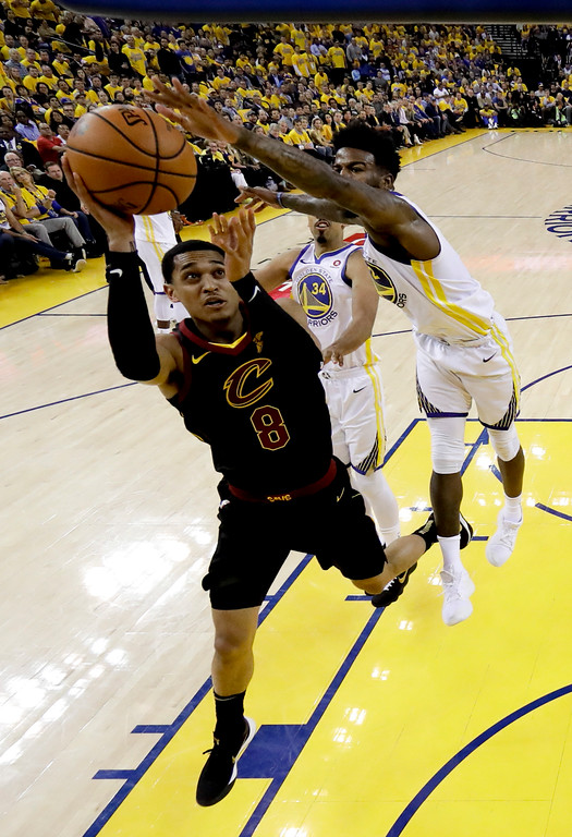 . Cleveland Cavaliers guard Jordan Clarkson (8) shoots against Golden State Warriors forward Jordan Bell during the first half of Game 1 of basketball\'s NBA Finals in Oakland, Calif., Thursday, May 31, 2018. (AP Photo/Marcio Jose Sanchez, pool)