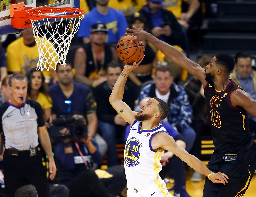. Cleveland Cavaliers center Tristan Thompson (13) blocks a shot by Golden State Warriors guard Stephen Curry (30) during the first half of Game 1 of basketball\'s NBA Finals in Oakland, Calif., Thursday, May 31, 2018. (AP Photo/Ben Margot)