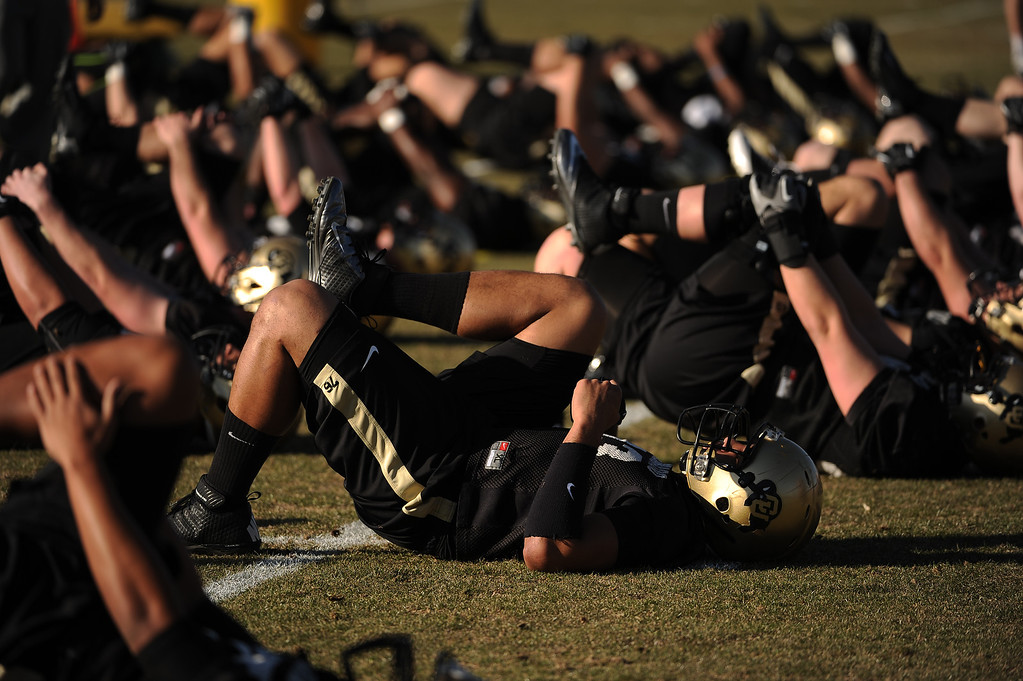 . BOULDER, CO- MARCH 7 :  Players warmup during practice. The Colorado Buffaloes football team hit the practice field for the first time this season with new head coach Mike MacIntyre in Boulder, CO on March 7, 2013. (Photo By Helen H. Richardson/ The Denver Post)