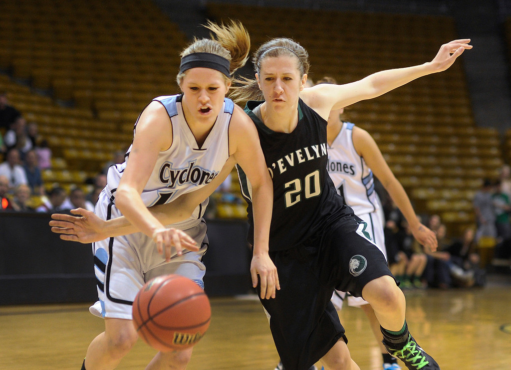 . BOULDER, CO. - MARCH 14:  Cyclones senior forward Daisy Romero (10) and Jaguars junior forward Mallory Seeman (20) chased a loose ball in the first half. The Pueblo West High School girl\'s basketball team matched up against D\'Evelyn in a 4A playoff game staged at the University of Colorado Events Center Thursday night, March 14, 2013.  (Photo By Karl Gehring/The Denver Post)