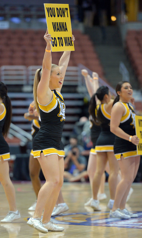 . LBSU cheerleaders perform at the Honda Center in Anaheim, CA on Thursday, March 13, 2014. Long Beach State vs CSU Fullerton in the Big West men\'s basketball tournament. 2nd half. LBSU won 66-56.  Photo by Scott Varley, Daily Breeze)