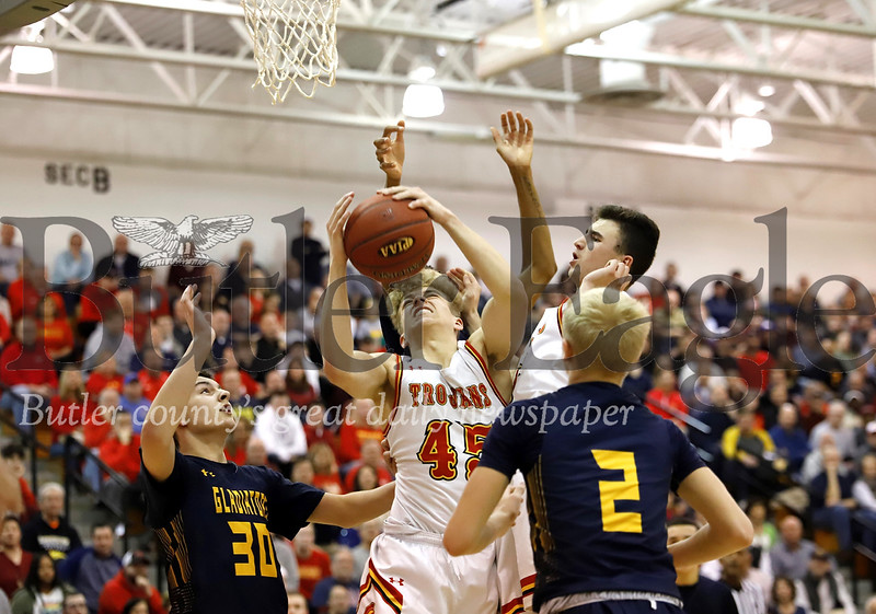 North Catholic's Andrew Ammerman fights for a rebound against South Allegheny in Monday night's WPIAL Playoff win. Seb Foltz/Butler Eagle