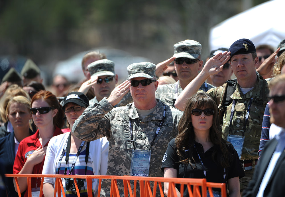 . Fans, families and Army personnel salute during the singing of the National Anthem before the races begin. The fourth annual Warrior Games cycling event took started and finished at Falcon Stadium on the grounds of the Air Force Academy in Colorado Springs, CO on May 12, 2013.  HRH Prince Harry was on hand to start the race as well as to hand out medals at the finish line.   A total of 260 wounded, ill and injured service members and veterans came to compete in the week long games.  Members of the Army, Marine Corps, Navy/Coast Guard/Air Force. Special Operations and the British Armed Forces all took part in the competition.  Other events included in the Warrior Games are shooting, sitting volleyball, track & field and wheelchair basketball.  (Photo by Helen H. Richardson/The Denver Post)