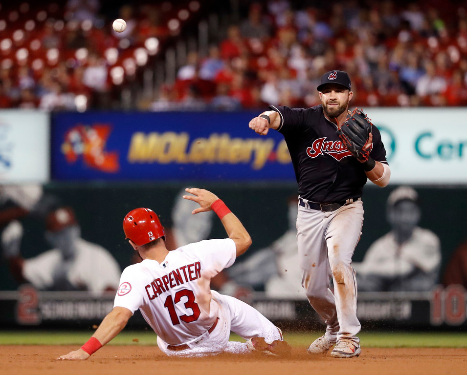 . St. Louis Cardinals\' Matt Carpenter (13) is out at second as Cleveland Indians second baseman Jason Kipnis turns the double play during the seventh inning of a baseball game Monday, June 25, 2018, in St. Louis. (AP Photo/Jeff Roberson)