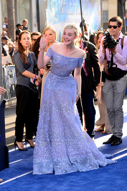 ". Actress Elle Fanning arrives at the World Premiere Of Disney\'s ""Maleficent\"" at the El Capitan Theatre on May 28, 2014 in Hollywood, California.  (Photo by Frazer Harrison/Getty Images)"