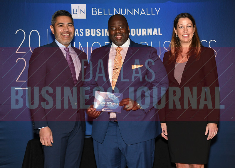 , (center) accepts her Minority Business Leader award from Chandhok, (left) and Mathes.