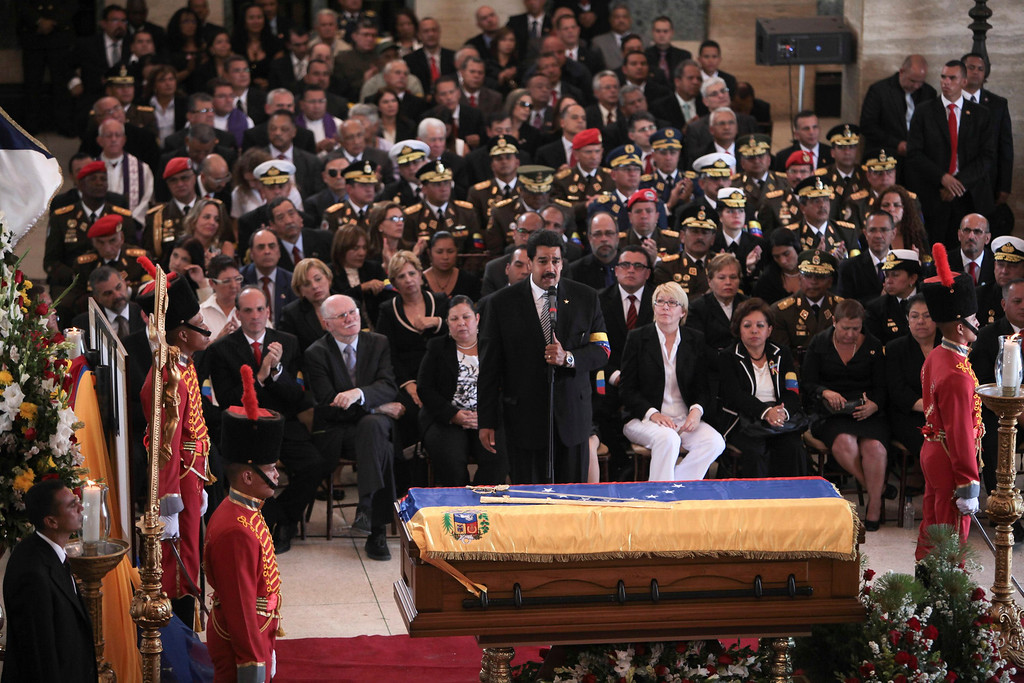 . Venezuela\'s Vice-President Nicolas Maduro (C) speaks during the funeral service for late President Hugo Chavez at the Military Academy in Caracas March 8, 2013, in this picture provided by the Miraflores Palace. REUTERS/Miraflores Palace/Handout